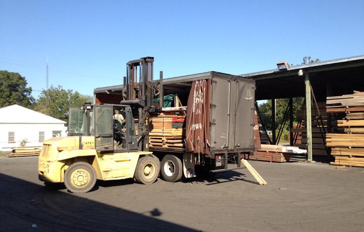 forklift loading truck at mcilvain