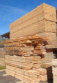 tall piles wood boards
