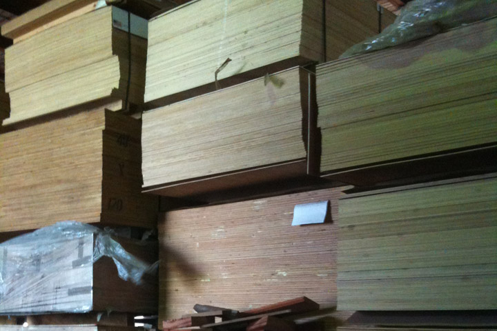 tall stacks of plywood boards